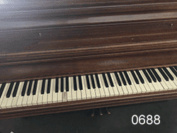 Used Chickering console Piano